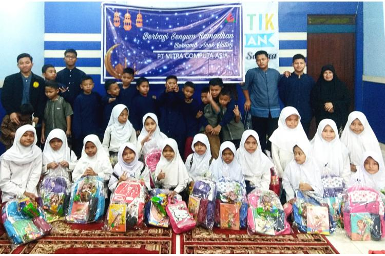 PT. Mitra Computa Asia representatives with orphans of Yayasan Panti Yatim Indonesia.